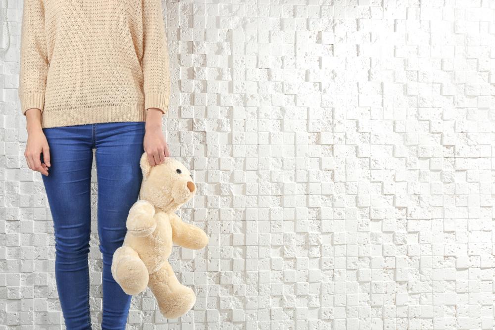 Child holding teddy bear