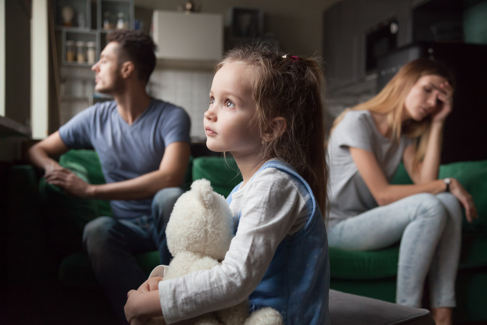 sad child with unhappy parents